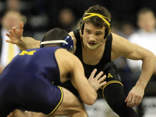 Iowa's Thomas Gilman wrestles Michigan's Conor Youtsey