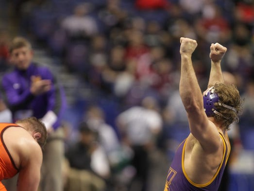 UNI heavyweight Blaize Cabell celebrates his 3-1 overtime