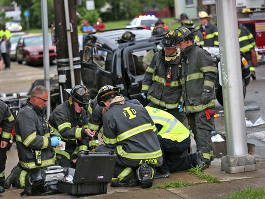 Emergency personnel work on a victim from the truck