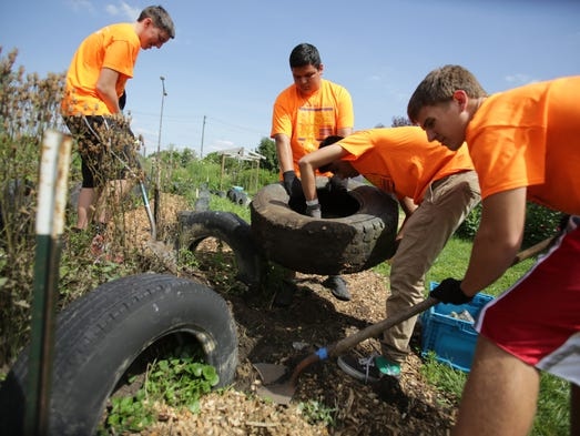 Volunteers clean up the garden at the Spirit of Hope