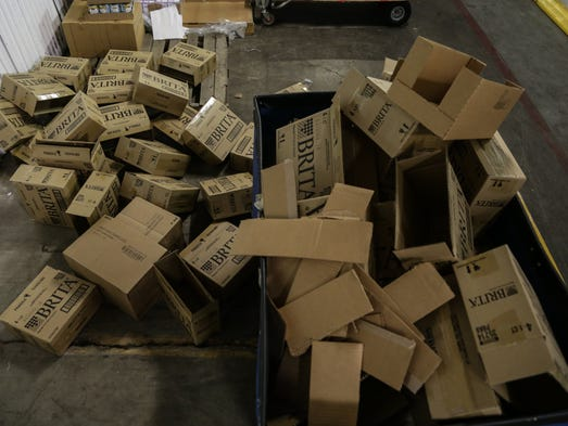 Empty boxes of water filters lay in piles as Flint