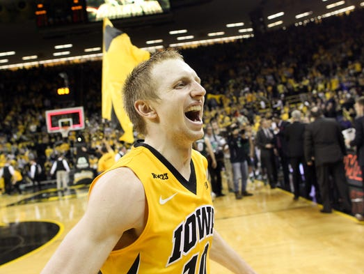 Iowa's Mike Gesell celebrates the Hawkeyes' 83-70 win