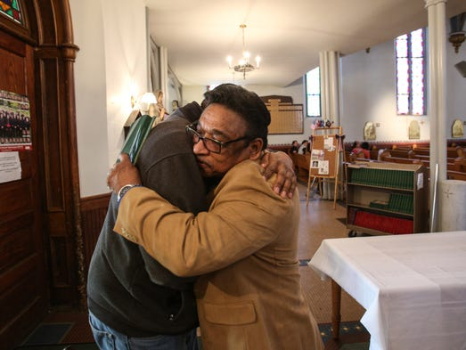 Head Usher Sanuhar Ali, 67, of Taylor greets parishioners
