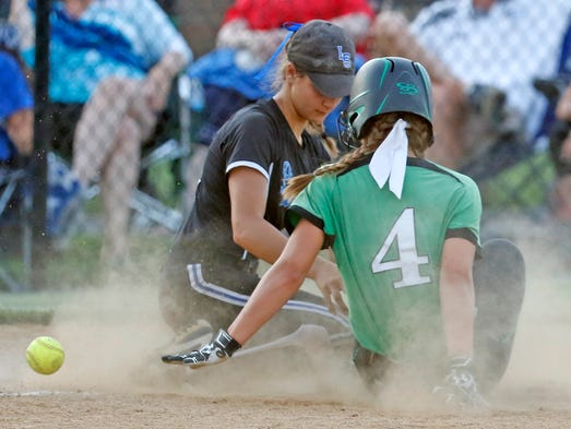 Donegal's McKenna Berg slides safely into third base