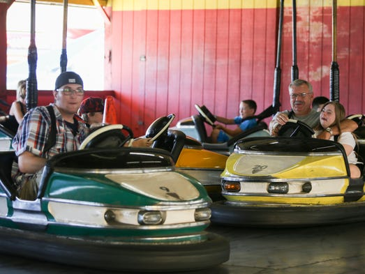 People ride on the bumper cars at the Indiana Beach