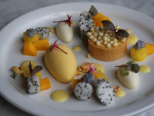 The enchanting mango tart dessert with coconut, yellow