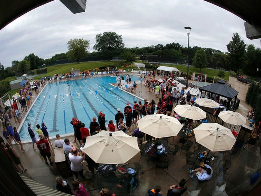 Spectators and swimmers look on during the 100 Yard