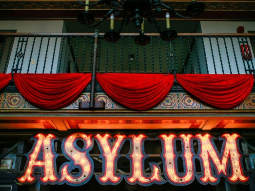 The Asylum sign points people in the right direction