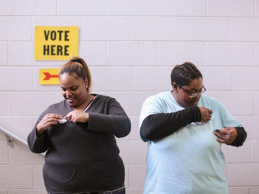 Alissa Woodford (left), 25 of Flint and Shonte Irving,