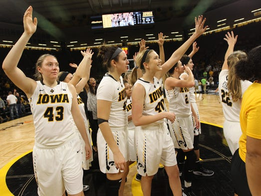 Iowa teammates wave to fans following the Hawkeyes'