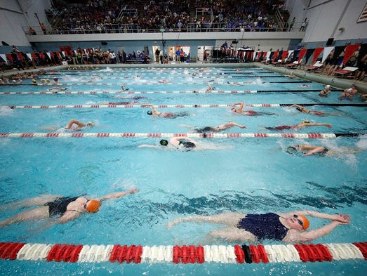 Swimmers warm up before the start of the WIAA Division
