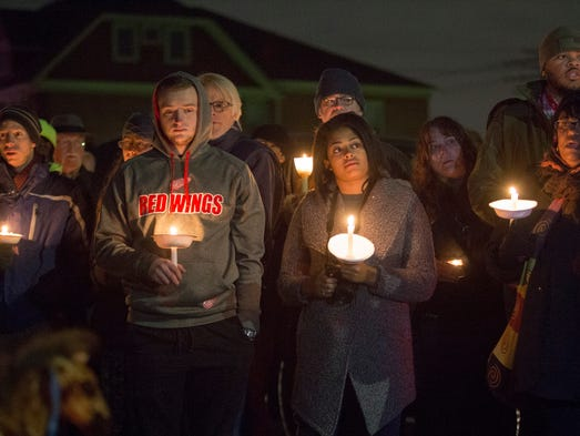 Neighbors, friends and police officers gather on Saturday