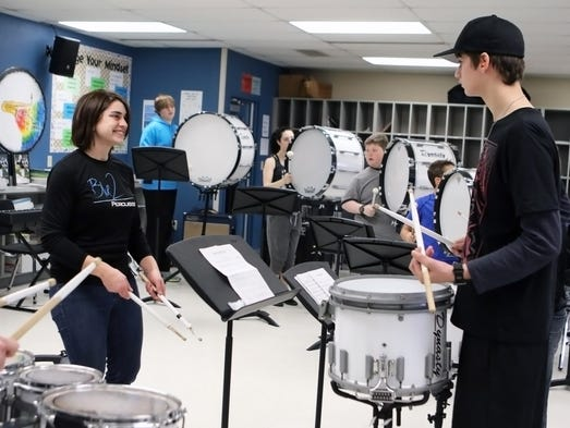 Blue 2 Percussion member Andrew Kramer (right) gets