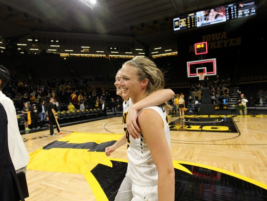 Iowa's Ally Disterhoft gets a hug from Makenzie Meyer