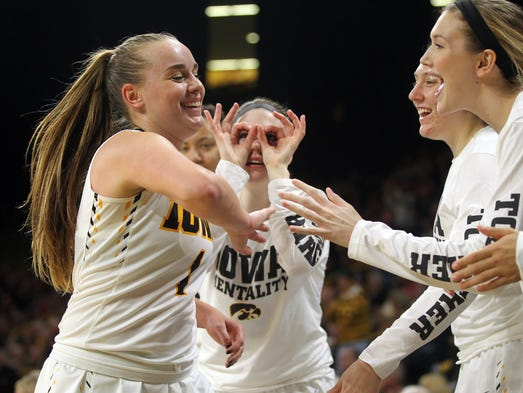 Iowa's Alexa Kastanek gets high-five's as she heads