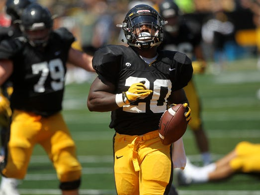 Iowa running back James Butler scores a touchdown during