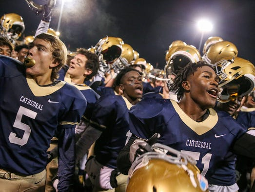 The Cathedral Fighting Irish celebrate by singing toward