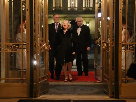 Art Roffey, Gail Danto, and Arnie Weingarden walk through
