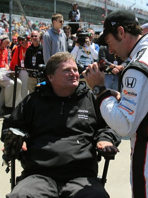 Simon Pagenaud speaks with Sam Schmidt after posting a speed of 230.614 during Pole Day for the Indy 500 at the Indianapolis Motor Speedway, Sunday, May 18, 2014, in Indianapolis.