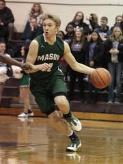 Mason's Matt King sprints out of the backcourt with the ball in a win over Middletown last season.