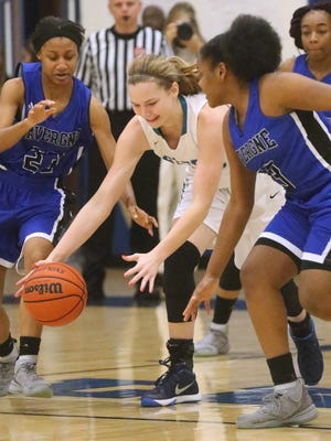 Siegel's Taylor Patterson (22) goes up fa loose ball between La Vergne's Brandi Davis (23) and Denise Hurd (33)during the game Wednesday, Feb. 17, 2016, at La Vergne.