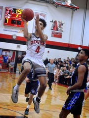 Keith Davis, seen here in action last season, has returned to Dover's lineup. Davis, who led the Eagles in scoring last season at 20 points per game, had missed the first half of this season with an injured shooting hand. DISPATCH FILE PHOTO