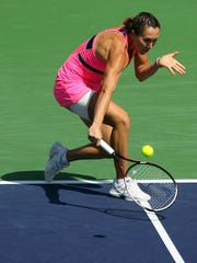 Jelena Jankovic of Serbia, the 2010 BNP Paribas Open winner, returns the ball to Ukrainian Lesia Tsurenko during a women's quarterfinal match Thursday morning in Indian Wells, Calif. Tsurenko retired in the second set due to injury and Jankovic won.