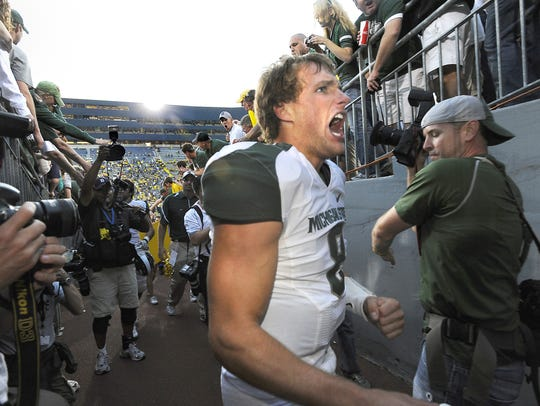 MSU quarterback Kirk Cousins lets out a yell as he