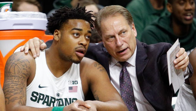 Dec 10, 2016; East Lansing, MI, USA; Michigan State Spartans head coach Tom Izzo talks with forward Nick Ward on the bench during the second half against the Tennessee Tech Golden Eagles at Jack Breslin Student Events Center.