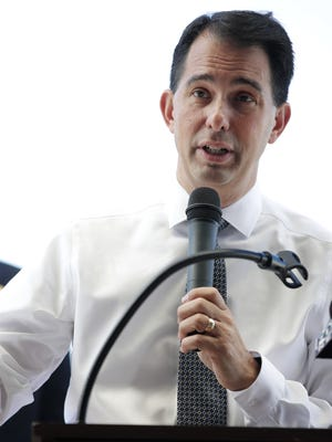 Gov. Scott Walker speaks about Foxconn Technology Group's decision to build in southeast Wisconsin during a stop Friday at Appleton International Airport in Greenville.