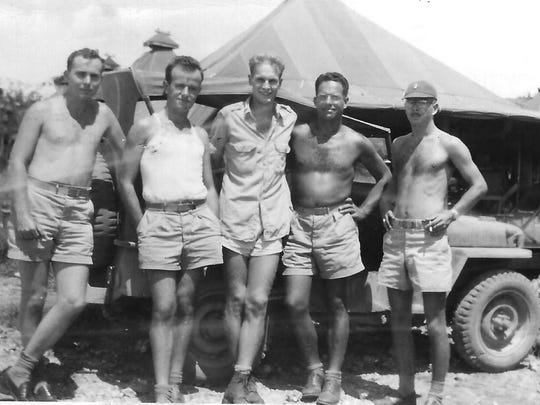 Retired U.S. Air Force Col. Thomas Haig (right) is shown with comrades while serving on Saipan in World War II. Haig, 96, joined the Army Air Corps during World War II to be a pilot but ended up in the meteorological division where he ran the Air Force's program that developed and launched the first weather satellite.