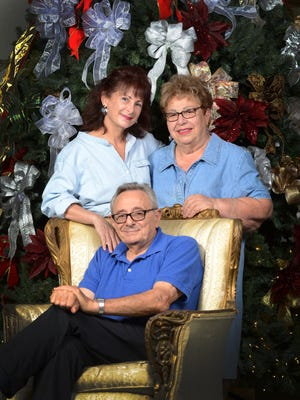 Dano LoPresti, seated, Angela LoPresti, left, and Rita LoPresti owned the Christmas Cottage since 1979.