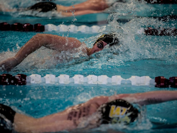 Issaac Hansen of Watkins swims the 200 freestyle at