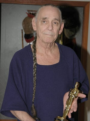 """Richard Portman, a retired professor at the FSU film school holds an Academy Award he won for the sound work on the movie """"The Deer Hunter."""" (1978)."""