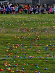 Children wait at the edge of the field at the Lee Sports Complex during the annual Evening Easter Egg Hunt Saturday.