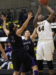 Alamogordo's Shiness Hills, right, puts up a mid-range shot Friday night at the Tiger Pit.