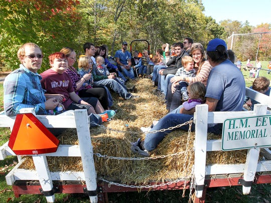 Area farms will offer hayrides,   pumpkin decorating and apple picking this fall.