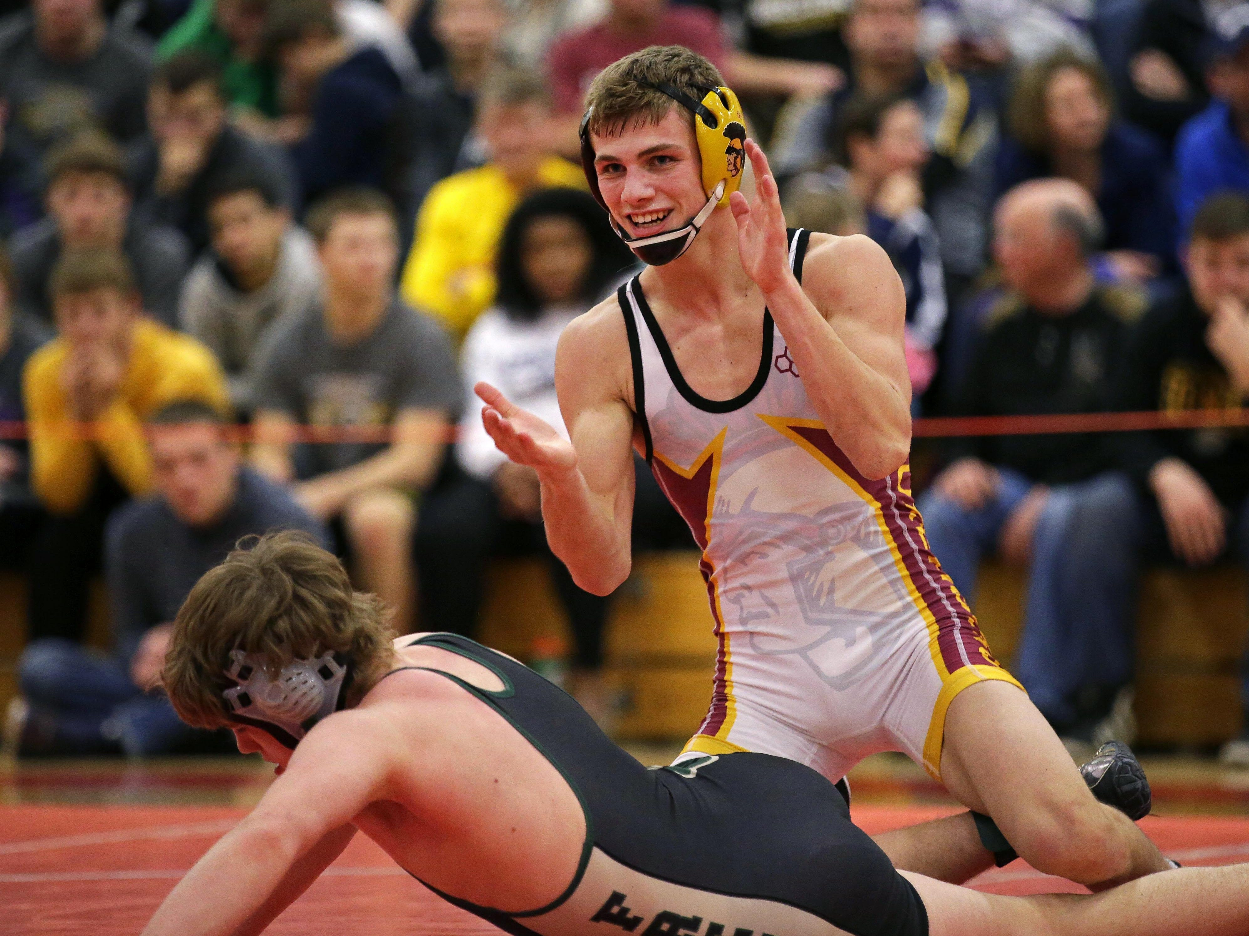 Nathan Ronsman of Luxemburg-Casco celebrates after defeating Mitch Garvey of Freedom in a 126-pound championship match at the WIAA Division 2 wrestling sectional Saturday at Seymour.