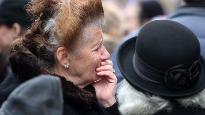 Berta Rabinovitch of Woodbridge becomes emotional after viewing the wreckage of her temple, Congregation Poile Zedek, Sunday, November 22, 2015, weeks after the historic New Brunswick temple was destroyed by fire.