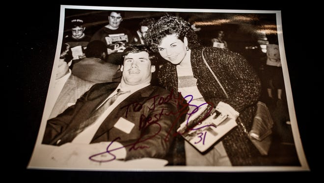 Jody Bowman brought a photograph of herself and former Penn State linebacker Shane Conlan from a previous York Sports Night to have signed by Conlan during the 53rd annual York Sports Night at Heritage Hills on Thursday, Feb. 9, 2017.