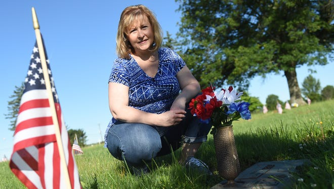 """When I left on Mother's Day, I was in tears,"" said Annette Fisher at the gravesite of her parents at Suburban Memorial Gardens in Conewago Township on Thursday, June 8, 2017. Fisher was distraught after finding the gravesite in poor condition and is taking action to remedy the situation."