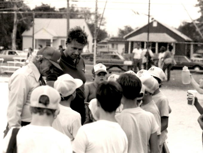 Tom Brown coaches kids in his Rookie League.