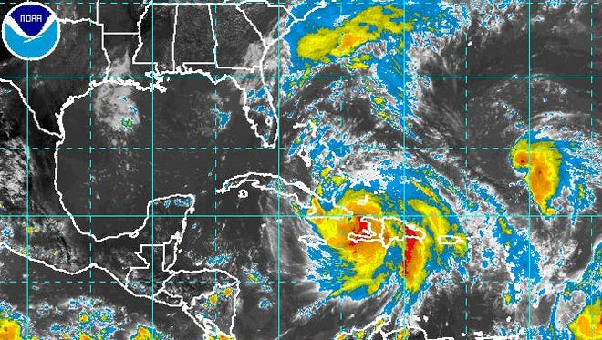 A satellite view of the Atlantic as a hurricane and tropical storm churn.