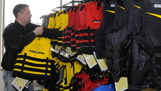 Sorting through life jackets at Grace Performance in Kimball Township, one of local businesses participating in the Shop Where Your Heart Is initiative this month.