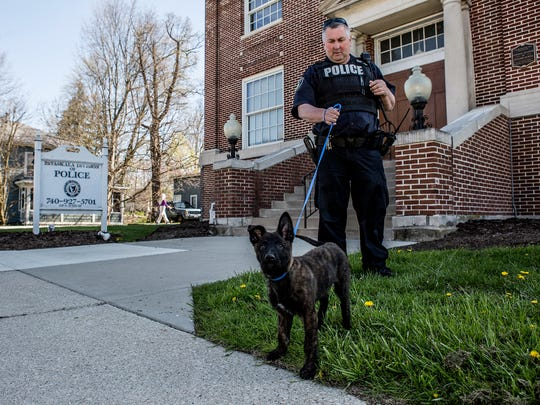 Pataskala Officer Randy Morton and his new K-9 officer, Demon, outside the Pataskala Police Department. Morton's previous K-9 partner, Junior, died unexpectedly last year after it was discovered he had cancer.