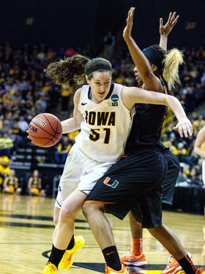 Iowa's Bethany Doolittle (51) scored 22 points and had 11 rebounds, both game highs, against Miami Sunday. The Hawkeyes beat the Hurricanes 88-70 to advance to the Sweet 16.