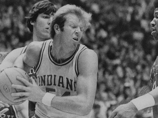 Indiana's Kent Benson takes a rebound away from Bruce Flowers (34), Bill Laimbeer and Adrian Dantley (right) of Notre Dame in 1975.