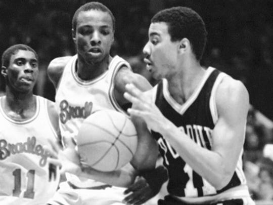 Purdue University's Keith Edmonson (11) gets his hands on the ball against Bradley in 1982.