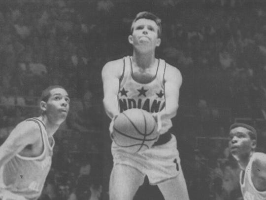 Billy Shepherd drives between Kentucky defenders Granville Bunton (left) and Henry Bacon during the 1968 Indiana  Kentucky All-Star game.