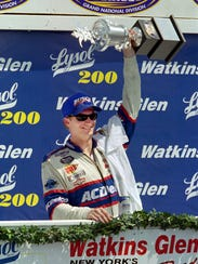 Dale Earnhardt Jr. celebrates his win in the XFINITY
